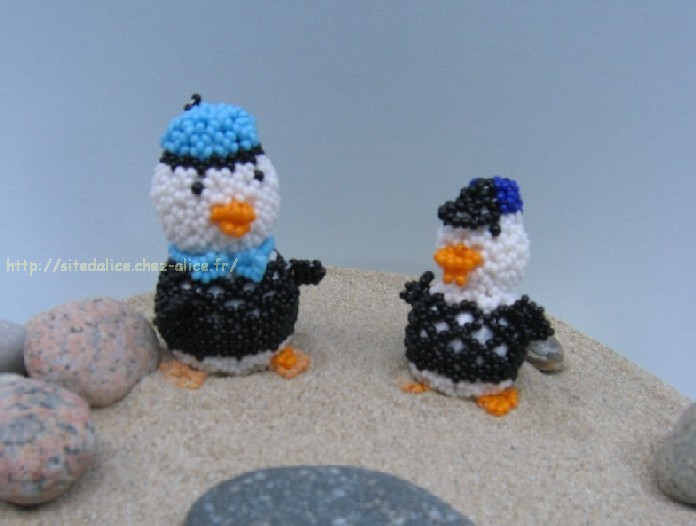 http://paysalice.free.fr//Albums/Perles/Tissage%20animaux/canard%20plage.jpg