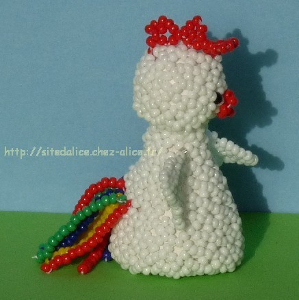http://paysalice.free.fr//Albums/Perles/Tissage%20animaux/coq%20cote%20els0409.jpg